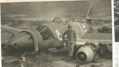 An American G.I. stands next to a downed Me-262, 1945