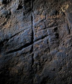 This abstract cave carving is possibly the first known example of Neanderthal rock art. The etching covers an area of about 47 square inches (300 square centimeters). Credit: Stewart Finlayson