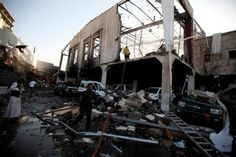 Yemeni civilians inspect the damage done by a massive airstrike that killed 140+ people.