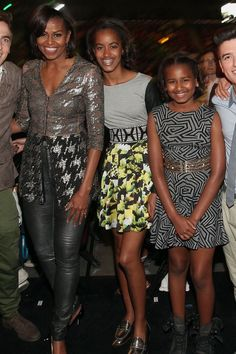 Michelle earned some major cool mom points by taking her daughters to the Kids' Choice Awards, where they wore belted looks with fun shoes.