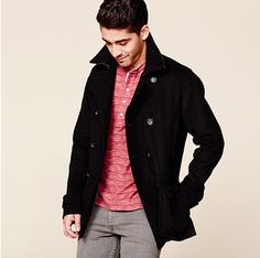 Top off your look with a timeless black coat.