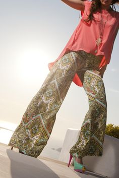 Silk touch flare pants, flat front with zip on the side.