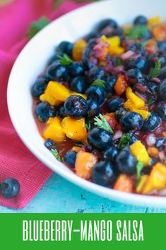 Blueberry-mango salsa should be a summer snack-staple in your home! Blueberry-mango salsa brings your a great snack that's a great switch from standard salsa. #snacks #snackideas #salsa #fruitsalsa #mango #blueberry
