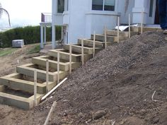 landscaping on a slope ideas   Here are some photos of landscape timbers stairs from one of my jobs.