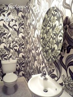Modern graphic wallpapered bathroom / cloakroom