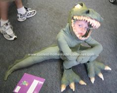 Tiny Terrifying T-Rex Costume T-Rex Costume: My four year son was obsessed with T-Rex's last year, so Mom had to deliver! I made his T-Rex head out of a children's plastic fire fighters helmet. T Rex Costume Kids, Dino Costume, Toddler Boy Halloween Costumes, Family Costumes, Dog Costumes, Costume Ideas, Animal Costumes, Holidays Halloween, Halloween Kids