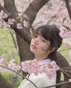 Cute school girl on Sakura tree 🌸🌸