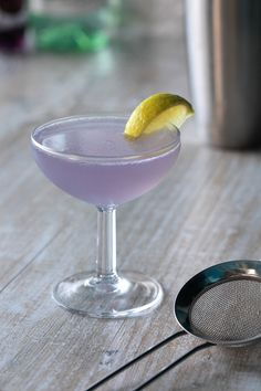 Royal Daiquiri Cocktail: 1 1/2 oz light rum, 1/2 oz Parfait Amour liqueur, 1/2 oz fresh pressed lime juice, 1 oz simple syrup. Shake all the ingredients in a shaker with a lot of ice. Strain into a beauty coupe glass and garnish with a lime wedge