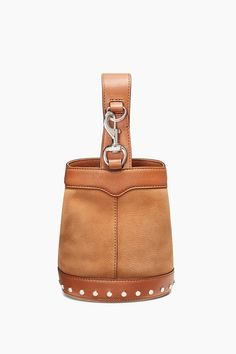 Mission Mini Sling Bucket - Definitely add this to your bucket list. It's everyone's favorite silhouette topped with an of-the-moment sling handle. The lady-like vibe is perfectly balanced with studs at the base and dog-clip hardware at the handle. Two textures add twice the fun.      Style #: HU17EMNM24