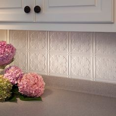 This 18 sq. ft. kit includes: Six (6) 18 x 24-inch backsplash panels, Four (4) 4 ft. J-trim pieces, Two (2) 18-inch inside corner pieces, and Four (4) rolls of double sided decorative wall tile adhesive tape.