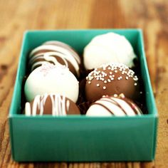 'Fudgy cake balls': Cake balls are the latest cake craze! Home-made fudgy moist chocolate cake, hand rolled and dipped in yet more chocolate. A box of six made with the freshest ingredients – not for the fainthearted.