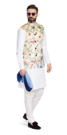 This Nehru Vest is inspired by the rich floral diversity of Portuguese royalty on a silk base. It has been carefully crafted with patch pockets and horn buttons. Style this piece with a light-coloured Kurta or shirt to enhance its appeal. Indian Formal Wear, Mens Indian Wear, Mens Ethnic Wear, Indian Groom Wear, Indian Men Fashion, Mens Fashion Suits, Groom Fashion, Mens Suits, Men's Fashion