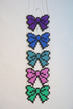 Perler beads bow necklace. A way to use them and show the designs off