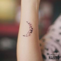 Small moon tattoo on the right wrist.