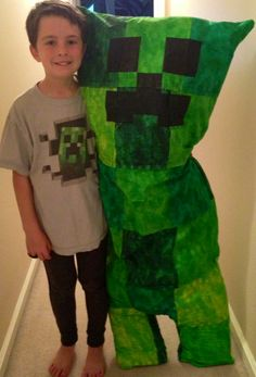 Minecraft Creeper - his sister made him this Creeper out of green quilt squares and a body pillow :)