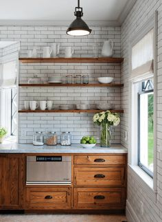 Must have this kitchen. extended subway backsplash, marble and natural cabinets. green accents