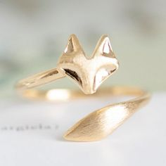 delicate gold fox ring