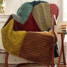 Rather than knitting all new blocks, just use old sweaters cut into squares