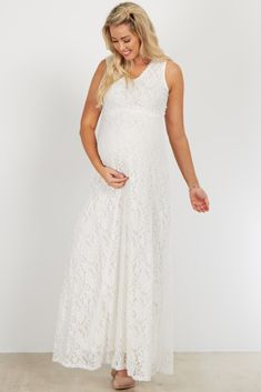 You will love this amazing maternity evening gown. Its gorgeous lace overlay and crochet trim detailing make this the ultimate dress this season. Dress up while looking and feeling amazing in this flattering, feminine chic style.