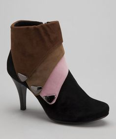 Feet will become the main event in any ensemble with this color block pair. Four different shades of faux suede form a bootie that's undeniably chic.