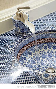 Persian sink. It's stunning! Oh man, I want an international themed home....furnished with things I bring home myself, of course! .....a mere tap and sink congers faraway places ....