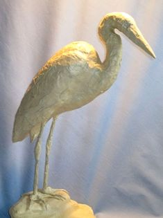 heron with masking tape over the armature