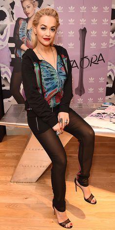 Rita Ora wearing a hoodie with mesh track pants and black mesh heels