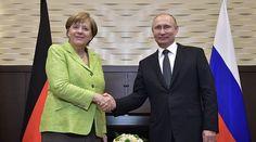 Vladimir Putin blasts western hypocrisy while standing next to Angela Merkel