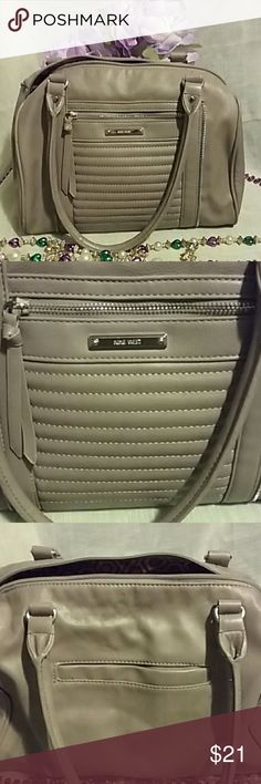 STYLISH NINE WEST Shoulder Bag Nine to 5 Purse and More, zipper pocket in front of purse, ribbed pattern in the front and zipper design in front of purse, pocket in back of purse, zipper compartment, within the zipper compartment, a zipper pocket and two smaller pocket, a beautiful pattern inside of purse, purse is Taupe color, hardware is silver, very light wear on front of purse, no other marks or rips, man made material, can fit quite a lot, shoulder straps are 9 inches Nine West Bags…