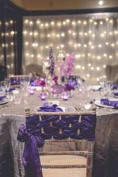 Sophisticated wedding reception table with purple chair decor; Via Enchanted Empire