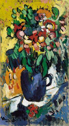 Jarrón azul con flores