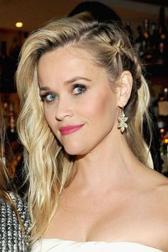 45 Braided Hairstyles That Are Anything But Boring- Reese Witherspoon- Reese may be known for a classic girl-next-door look, but her latest style shows she's got a little bid of edge, too. Get more hair inspiration from your favorite celebs at redbookmag.com