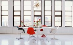 Herman Miller and Knoll together: Eames Plastic chair and Saarinen table making a perfect happy match.