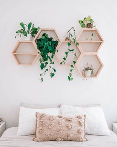 The Om Home: Our Modern + Minimal Master Bedroom Today, I'm revealing our new master bedroom. We wanted to make our bedroom a peaceful, relaxing retreat, and I say goal accomplished. I also share our experience with making homemade hexagon shelves.