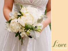 This bouguet has a wonderfully handpicked feel.  The shape, colors and flowers compliment the bride's dress perfectly.