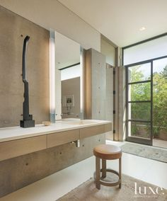 Contemporary Neutral Bathroom with Steel Sculpture