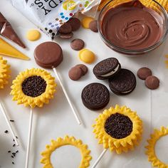 Celebrate the change of seasons with these sunny-in-design, easy-to-make Sunflower Cookie Pops. Begin with chocolate sandwich cookies for the bases, add Yellow and Light Cocoa Candy Melts® candy and Chocolate Jimmies Sprinkles for the ray flowers and flo Sunflower Birthday Parties, Sunflower Party, Sunflower Baby Showers, Sunflower Cake Ideas, Sunflower Wedding Favors, Cookie Pops, Cupcake Decoration, Cookie Cake Decorations, Sunflower Cookies