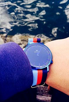The fashion welly merck watch is integrated into the sea and blue sky.
