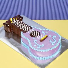 Pop Star Guitar Cake: Just made this for my daughter's fifth birthday. It wasn't too difficult, and she loved it!   :)