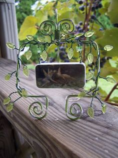 """Wendy Joan Howell  Domino sculpture. Wire and glass beads. Graphic from Dover Publishing's, """"120 Great Victorian Fantasy Paintings CD-Rom and Book"""""""