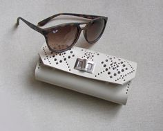 This beautiful 100% handmade leather sunglasses case is made of beige heavy leather, so it is quite strong and will protect your sunglasses from