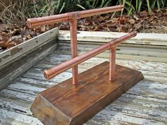 Wooden Bracelet Stand with Copper Rack // Reclaimed Wood Bangle Display // Industrial Bracelet Stand // Modern Rustic Bangle Display by TheBradfordEdge on Etsy https://www.etsy.com/listing/218576431/wooden-bracelet-stand-with-copper-rack
