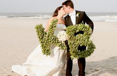 Boxwood initials- great photo props! // photo by http://cynkainphotography.com, see more: http://theeverylastdetail.com/2013/09/13/classic-eclectic-pink-green-new-jersey-wedding/