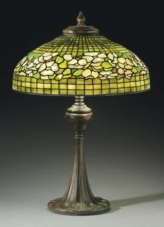 """** Tiffany Studios, New York, Favrile Leaded Glass and Patinated Bronze """"Dogwood"""" Lamp."""