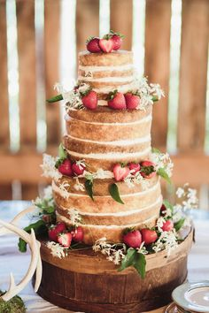 Naked Wedding Cake with Strawberries -- On #SMP. See more here: http://www.StyleMePretty.com/southeast-weddings/2014/03/26/barn-wedding-at-high-point-farms/ John Shim Photography - johnshim.com
