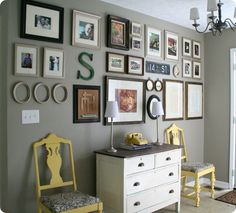 Electic wall collection with framed photos, art, shapes and signs. And love the yellow acccent chairs.