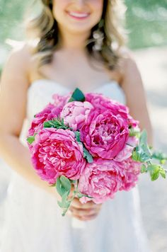 Fluffy, bright pink peonies are the ultimate feminine flower for brides. Pair it with a hot pink lip and you're wedding-ready!