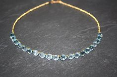 Blue topaz and 14k gold necklace. beautiful!