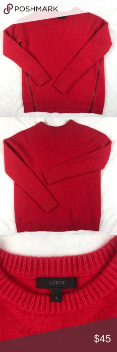 """J. Crew Lambswool Zip Sweater Red J. Crew Lambswool Zip Sweater in red. Sweater is relaxed fit and hits slightly below hip. Can be worn with side zippers unzipped. Lambswool in a 7-gauge knit. Rib trim at beck, cuffs, and hem. 100% wool. Dry clean. Slightly longer in back. Length measures 22"""" in back and 21"""" in front. Bust measures at 19"""". J. Crew Sweaters Crew & Scoop Necks"""