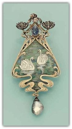 AN ART NOUVEAU ENAMEL AND GEM-SET PENDANT/BROOCH, BY ROBERT KOCH - Designed as a pliqué-a-jour enamel scene of two swans on water, the surmount designed as diamond-set waterlilies, an iris and an oval sapphire, and supporting a drop-shaped grey pearl, circa 1900. #GoldJewelleryArtNouveau